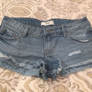 Forever 21 distressed denim jean  shorts . Size 24